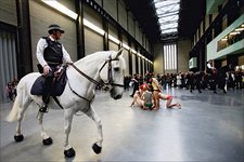 Performance of Tania Brugueras Tatlins Whisper 5 in the Turbine Hall at Tate Modern 2008