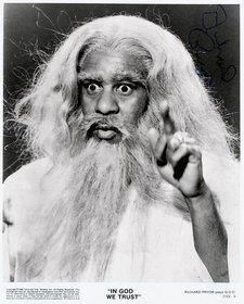 Promotional photo of Richard Pryor in the film In God We Trust 1980 image of a man with a long white beard and hair his finger is pointing upwards