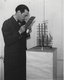 Paul Nash examining his sculpture Moon Aviary through a blue glass screen which gave a 'moonlight effect' for the viewer