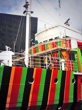 Carlos Cruz-Diez's dazzle ship is unveiled at Liverpool dock