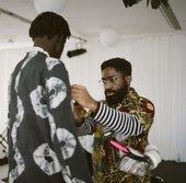 Stylist dressing a musician
