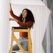 Set designer fixing the curtain