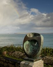 A Barbara Hepworth sculpture in front of the sea