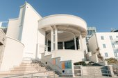 photograph of Tate St Ives, a large modern building with a central rotunda