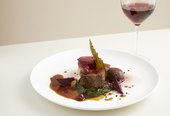 photograph of a main course & glass of red wine at the tate britain restaurant