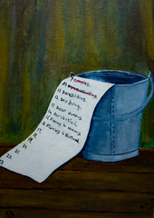 a bucket on a wooden floor with a list coming out of it