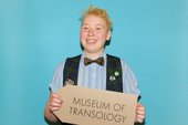 Colin Lievens holding the Museum of Transology sign