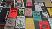 Glass case filled with zines