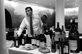 Head Sommelier Gustavo Medina prepares wines for service