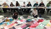 Image of children collaging paper