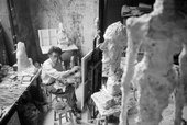 "Giacometti painting in his Paris studio, in the foreground ""La Grande Tête"", 1958"