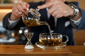 Picture of man pouring tea