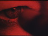 Still from the film Charlotte showing a red eye