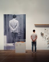 person stood in exhibition gallery