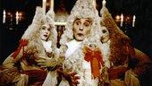 Three theatrical men in white wigs