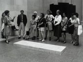 Tate Gallery visitors viewing Carl Andre's sculpture Equivalent VIII 1966