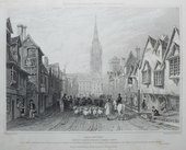 A black and white print of a bustling street scene featuring a road in the centre occupied by figures, horses and a flock of sheep, with buildings either side and Salisbury Cathedral's spire in the background.