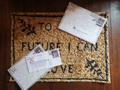 Letter on a doormat, reading A Future I Can Love