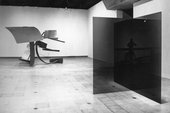 Installation view showing Larry Bell, Untitled 1971–2 (right) and David Evison, Number Six 1975 in The Condition of Sculpture: A Selection of Recent Sculpture by Younger British and Foreign Artists, Hayward Gallery, London, 1975