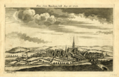 A black and white print of a landscape featuring hills, trees, meadows, a cloudy sky, and Salisbury Cathedral and rows of houses in the distance.