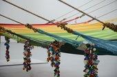 Children playing in colourful hammocks
