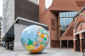 large monumental scale blow up globe installed in a courtyard