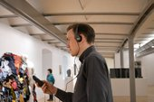 Visitor listening to Tate Liverpool's audio guide