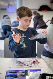 Photograph of a child at a Family Collective event at Tate Liverpool