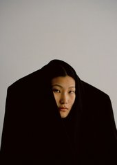 photo of a woman with her head poking out of a suit