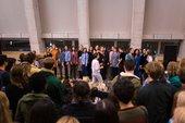 An all- female choir singing at Tate Modern