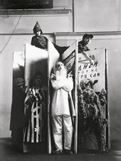 Varvara Stepanova Designs for the performance ofAn Evening of the Bookwith the protagonists standing in front, photographed by Alexander Rodchenko 1924