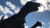 a toy dinosaur looks up at the sky