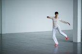 Anne Van Aerschot dancing in an empty room