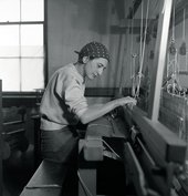 Anni Albers weaving on the loom