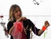 Girl making art in response to music
