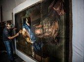 A conservator restoring Michael Dahl's portrait Rachel Russell, Duchess of Devonshire c1696