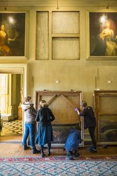 Curators inspect one of Michael Dahl's paintings in the Beauty Room at Petworth House, West Sussex