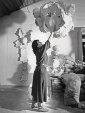 Maria Batuszová in her studio in Košice, Slovakia, with her sculptures evoking nests, hollowed eggs, shells and other natural forms, c1987