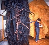 Photograph of Magdalena Abakanowicz working on one of her Abakan sculptures