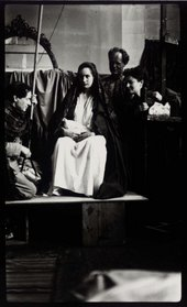 Photograph of Duncan Grant, Angelica and Quentin Bell, and Chattie Salaman posing in costume for the Berwick Church murals © Tate Archive