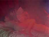 a man and a woman in bed red haze over the image
