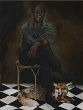 a man sits in a chair with a fox underneath on a tiled floor