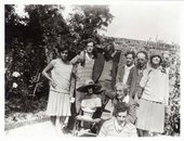 Photograph of family and friends of Vanessa Bell in the walled garden of her home, Charleston farmhouse, in Firle, Sussex