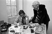Black and white photograph of Bob Colacello and Andy Warhol in the offices of Interview magazine