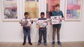 Three boys in Rauschenberg exhibition