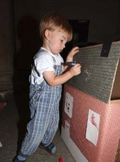Kid adding details to his house