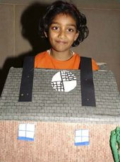 Kid wearing his house