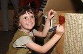 Kid making her house
