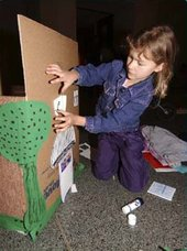 Kid adding details to her house