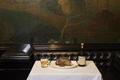 plate of haggis next to bottle of whiskey in rex whistler restaurant